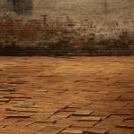 Elisabetta Benassi, The Dry Salvages, 2013, installazione site-specific, circa 10.000 mattoni, sabbia e un libro, dimensioni ambientali. Courtesy l'artista e Magazzino, Roma. Foto Roberto Galasso