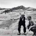 Sicilian peasant telling an American officer which way the Germans had gone, near Troina, Italy, 4-5 August 1943