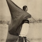 Tina Modotti, Woman with flag (Mexico City), 1928, Courtesy Galleria M&D Arte, Gorgonzola