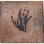 untitled wood burned with handprint