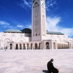 Ammar Abd Rabbo A man is praying outside the Hassan II Mosque in Casablanca, Morocco, 1996