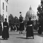 © David Seymour / Magnum Photos ITALY. Vatican city. Black seminarists playing volley-ball. 1949.