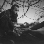 World Press Photo of The Year e Spot News, 1° Premio Warren Richardson, Hope for a New Life