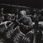 Eugene Smith_Mill Man Loading Coiled Steel