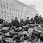 Pavel Wolberg Ukrainian civilians stand behind a barricade as they watch riot police lines near the Maidan square in Kiev, 2014