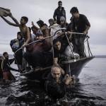 Sergey Ponomarev Migrants arrive by a Turkish boat near the vil- lage of Skala, on the Greek island of Lesbos. Monday 16 November 2015