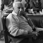 "Picasso at his villa La Californie. Behind him the sculpture ""Tête de femme (Dora Maar)"", 1941. Cannes 21 Nov 1957."